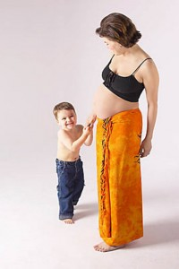 Pregnant mother with son - Good Counsel pregnancy crisis services